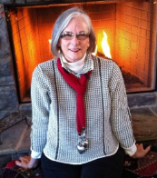 CCBS Founder Beth Black by Fireplace